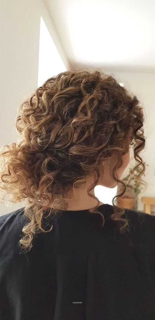 This year curly natural hair reigns supreme. Bridal curly hair updo by ossahair.