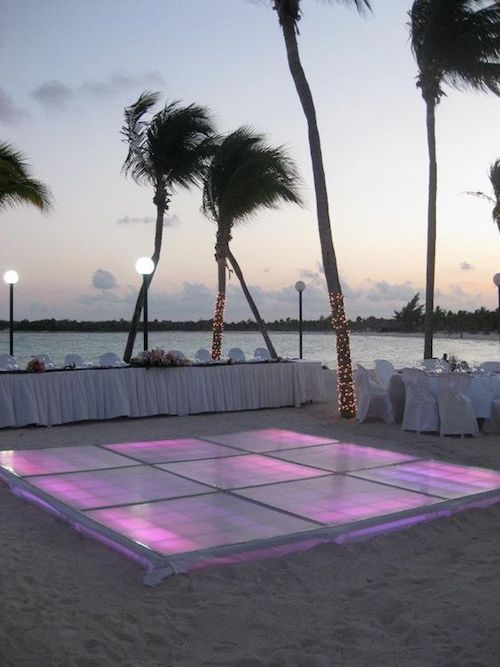 Can you imagine what this dance floor will look like at night? Beach receptions can totally rock.