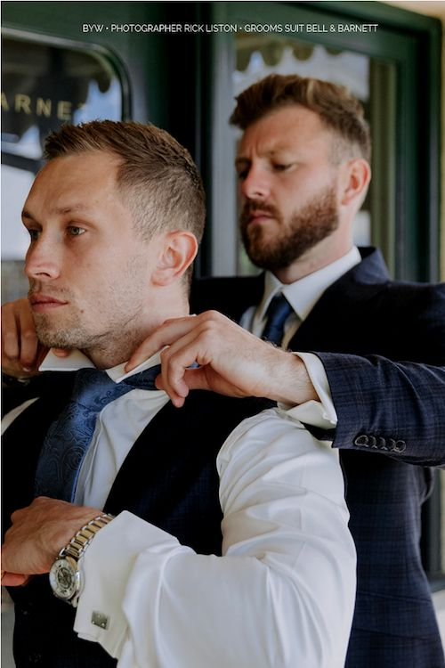 Getting your best friend ready for his wedding is a serious matter and needs to be done properly. Photographer: Rick Liston. Venue: Flowerdale Estate. Groom's suit: Bell & Barnett.