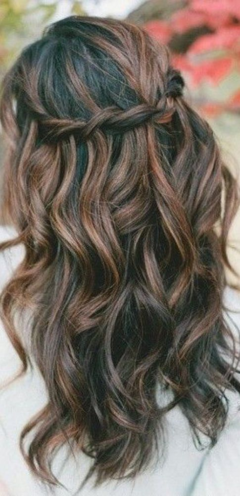 Half-up half-down braided wedding hairstyle.