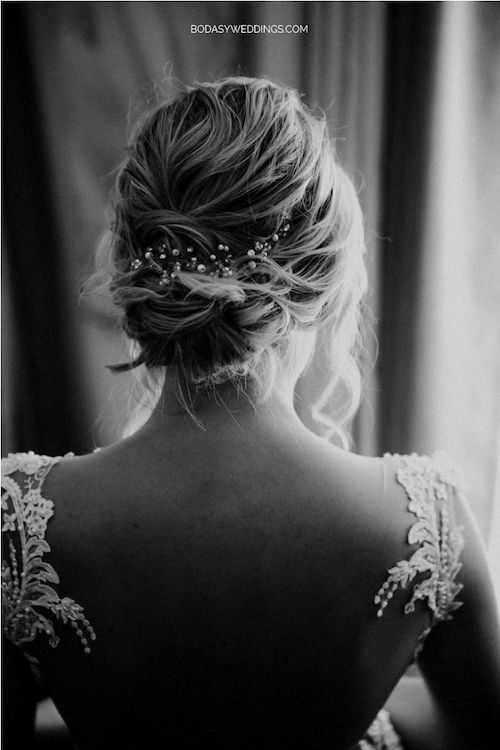 Low braided bun with pearl accessory and a backless gown. Photo: BYW