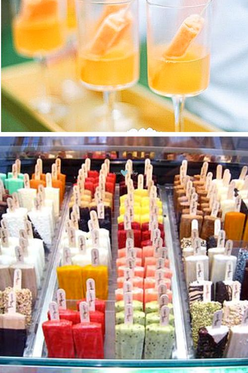 Orange gelato dipped in champagne. A steal-worthy popsicle presentation for a colorful wedding reception.