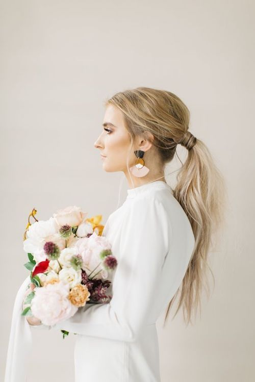 Classy, elegant and sleek ponytail for brides.