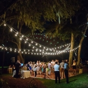 Wedding dance floor ideas that will make your heart sing. String lights at an outdoor reception at RiverOaks in Charleston. Photo: Clay Austin.